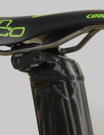 The Warp seems to have a small elastomer insert near the top of the large aero seatpost, and very solid-looking clamps