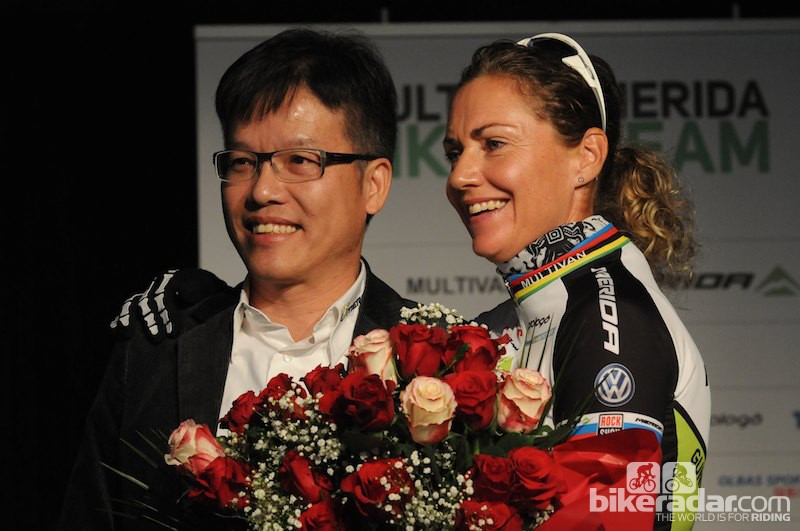 Gunn-Rita Dahle Flesjå being presented with a bouquet to celebrate her 40th birthday