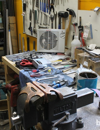 The cluttered workbench of a busy builder