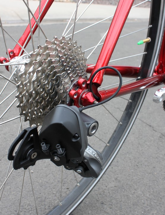 The wire for the rear derialleur exits out the chainstay