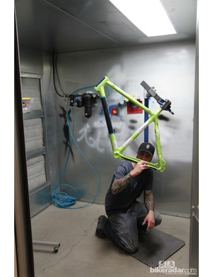 This paint booth gets a lot of use inside the Alchemy Bicycles workshop. Painter Shane Haberland checks out the masking quality before spraying