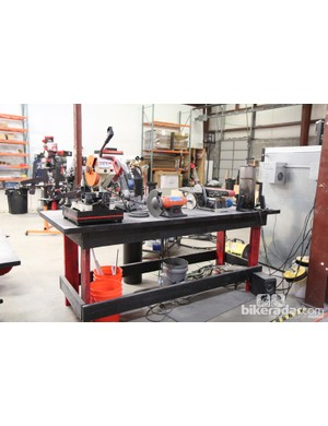 Saws, sanders, and grinding wheels share space on this workbench