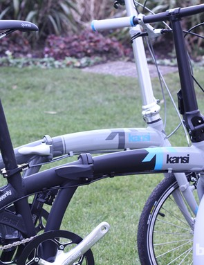 The side-by-side Kansi 3twenty bikes (2013 background, 2014 foreground) show the design tweaks to come