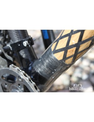 The bamboo tubes are wrapped with strips of carbon fiber to carbon lugs