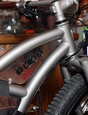 The mini-triangle created by the curved titanium tubes provides a perfect place to call one of the benefactors of this Moots creation