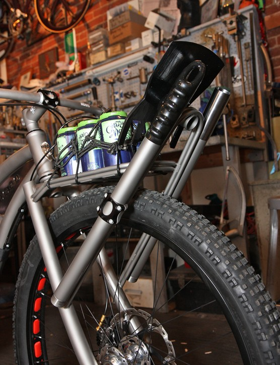The front rack holds a custom three-piece McLeod titanium trail tool