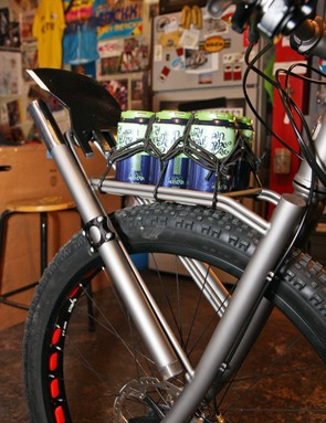 There's also room on the front rack for a six-pack —  because building trails makes people thirsty