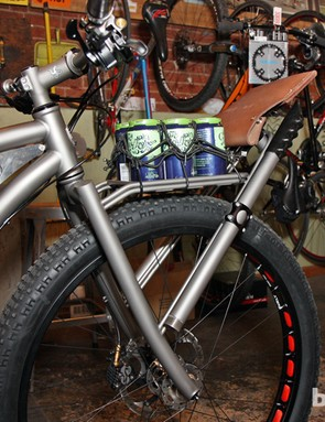 The front rack looks massively overbuilt until you realize there's a custom titanium McLeod attached