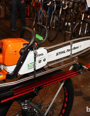 The rear rack is perfectly sized for a chainsaw. And don't be fooled by the Feedback Sports Sprint workstand tray on the side. That's just part of the rack that's holding the bike up on display