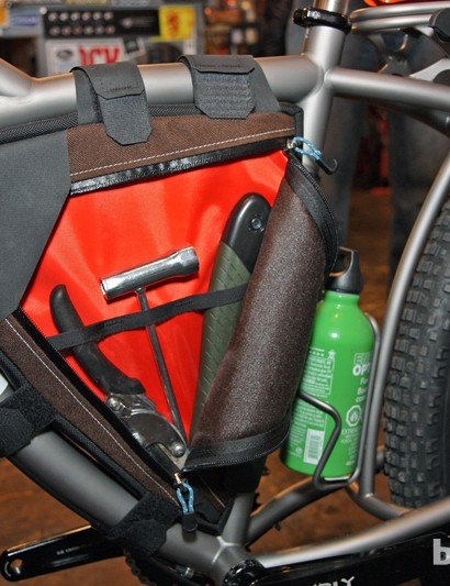 The custom main triangle bag holds other trail building essentials such as a folding saw and loppers
