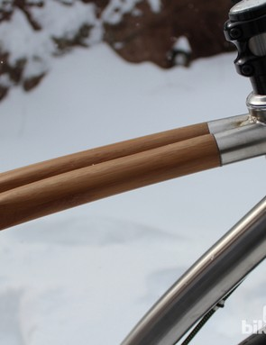 The bamboo is is cut on the miter and butts up against the head tube inside the titanium sleeves