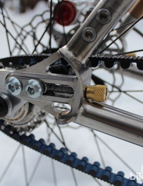 Integrated chain, err, belt tensioners keep things tidy