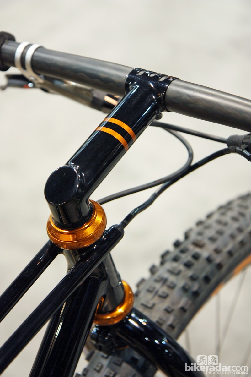 Rob English's trademark one-piece stem and steerer inserts down through the head tube and then is clamped down at the fork crown