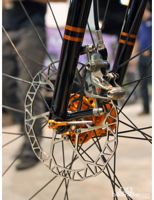 The front brake caliper mounts to impossibly minimal posts