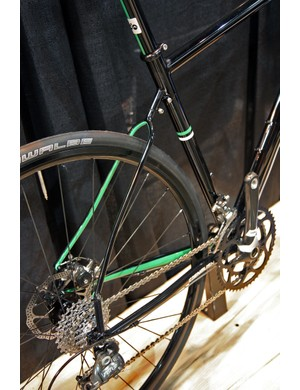 The seat stay wishbone separates with a single bolt, the stays collapse on to themselves, and then the entire rear end pivots about the bottom bracket to sandwich the front triangle. Brilliant