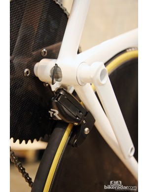 The bottom bracket and crank are also 100 percent custom built. Two cartridge bearings are pressed into the driveside and one on the non-driveside. The crankset spindle bolts together in the middle. Check out the tidy routing for the TriRig rear brake, too