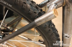 Pennies are brazed on top of the steel and carbon chainstays