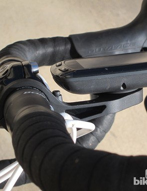 Garmin uses a hinged and rubber coated clamp on its Out-front mount for newer Edge computers