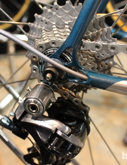 The rear derailleur cable is routed through the chainstay
