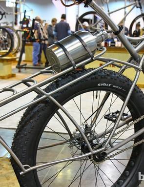 This tubular titanium rear rack is both beautiful and capacious