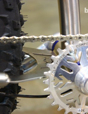 Instead of a traditional pivot, Black Sheep's full-suspension snow bike uses a titanium flex plate
