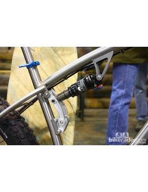The rear shock is driven by a chunky aluminum link
