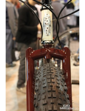 The bike has a non-suspension corrected fork to keep the front end low