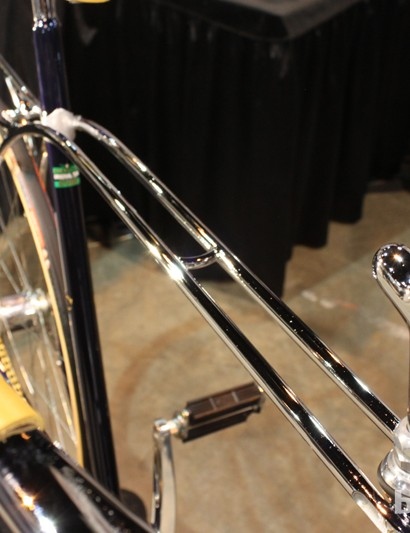 They arc backward and make the seatstays, too