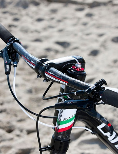 There is an FSA K-Force bar (670mm) with 9 degrees of backsweep and 4 degrees of upsweep