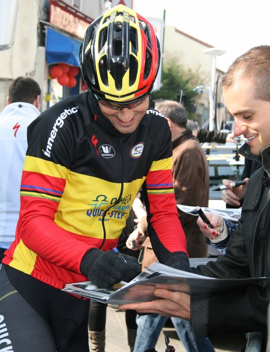 Belgian champ Tom Boonen does his duty with the fans