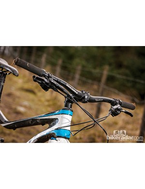 A wide, 720mm bar highlights the twist between the front and rear of the bike