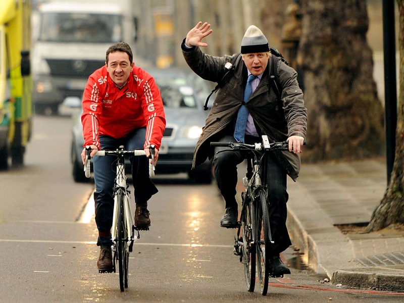 "Mayor of London Boris Johnson and Chris Boardman (left) arrive on bicycle for a press conference on Victoria Embankment to launch ""Crossrail for the Bike"", a new vision for cycling in London"
