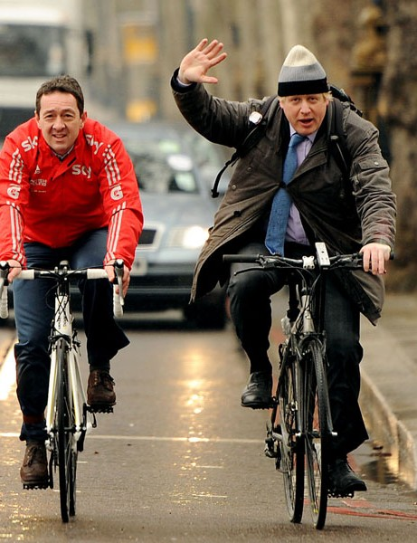 Mayor of London Boris Johnson and Chris Boardman (left) arrive on bicycle for a press conference on Victoria Embankment to launch