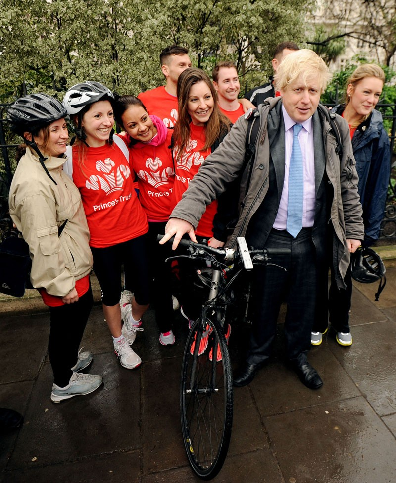 "Mayor of London Boris Johnson poses with members of the Princes Trust during a press conference on Victoria Embankment to launch ""Crossrail for the Bike"", a new vision for cycling in London"
