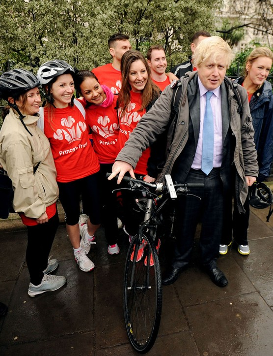 Mayor of London Boris Johnson poses with members of the Princes Trust during a press conference on Victoria Embankment to launch