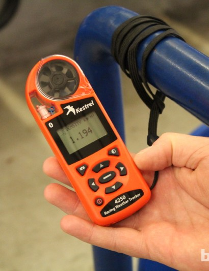 Air density is measured and included in the calcuations. Besides the still air of an indoor track, the consistent humidity is also necessary for accurate measurement
