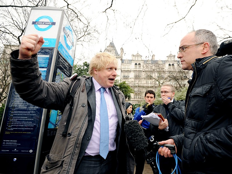 "Mayor of London Boris Johnson (left) is interviewed during a press conference on Victoria Embankment to launch ""Crossrail for the Bike"""