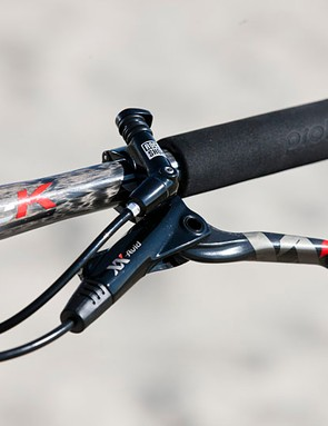 On the left side of the cockpit are an Avid XX World Cup brake lever and lockout for the Lefty fork