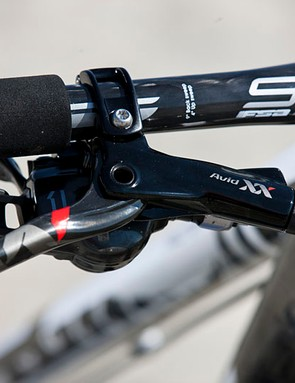 On the right side of the cockpit are an Avid XX World Cup brake lever and SRAM XX1 rear shifter