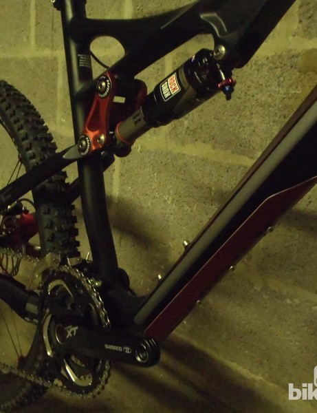 A Carbon Protection Shield appears on the Heet RC, as does the RockShox Monarch shock
