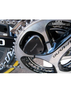 The new Pioneer power meter consists of two separate sensor units, one bonded on to the back of each crankarm. The plastic box zip-tied in between the chainring spider arms is the transmitter