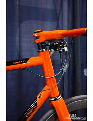 The front end of this Caletti features a 44mm head tube housing an ENVE tapered fork and a TRP Parabox mechanical-to-hydraulic conversion system