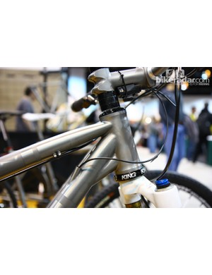The front end is reinforced with an ovalized top tube and a gusset beneath the down tube