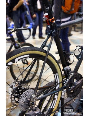 Gloss lugs contrast with matte finish tubes on this Calfee 'adventure road' bike