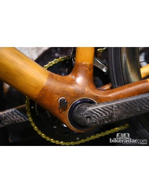 The huge bottom bracket shell on this Calfee bamboo bike also allows for internal mounting of Campagnolo's EPS battery and brain - plus a handy charging port built right into the frame