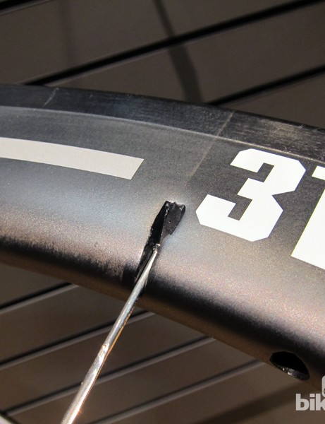 3T figured out a rather clever way to get around spoke holes entirely on its new Mercurio carbon tubulars. Spoke heads are anchored into molded-in pockets on the side of the rim, meaning you don't even have to remove the tire to replace a spoke