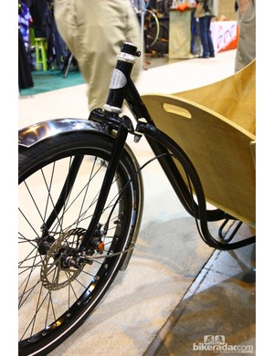 The burly segmented steel fork features a small tab on the crown for the steering linkage