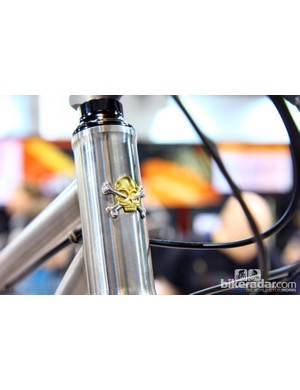 What's better than a real head tube badge? A two-tone one that includes real gold