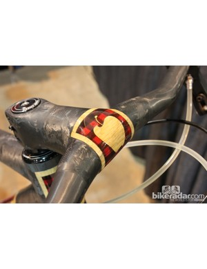 A Ritchey stem and handlebar are wrapped in carbon to create a seamless look