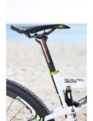 An FSA K-Force seatpost (31.6mm diameter) with 0-degree setback holds on his saddle